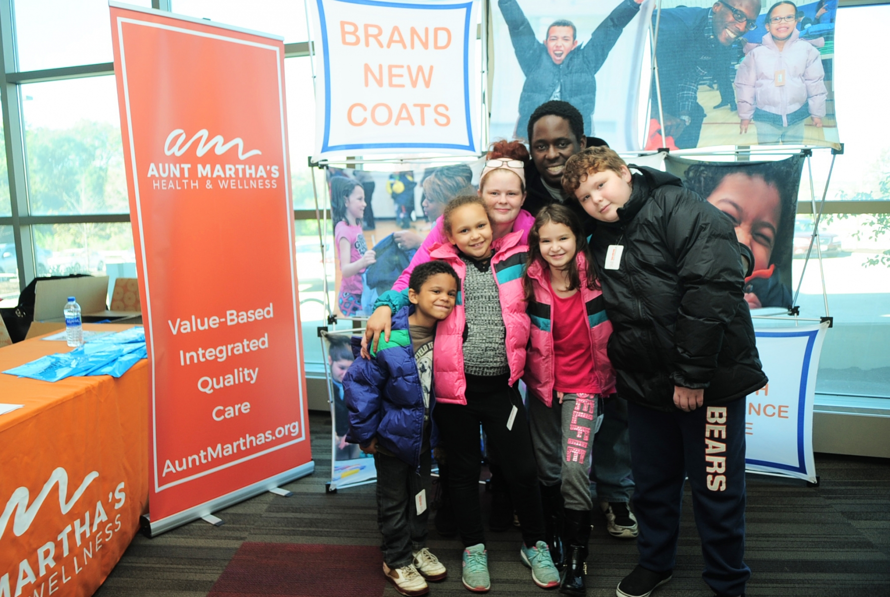 10-20-18 Aunt Martha's Coat Drive and Flu Shots, Joliet IL Ashley Dixon and Montez Harmon, join their kids (L-R) Trevian, Serenitie, Harmony, and Jonathon in proudly showing there new winter coats they received at the Operation Warm give away at Aunt Martha's.    Photo by John Booz